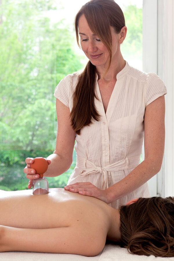 """A young woman patient is being treated with cupping, an alternative medicine procedure"""